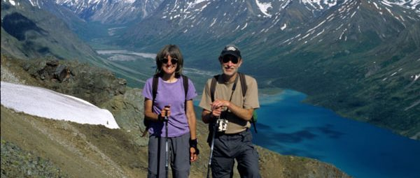 Mark and Joan Strobel hiking in mountains