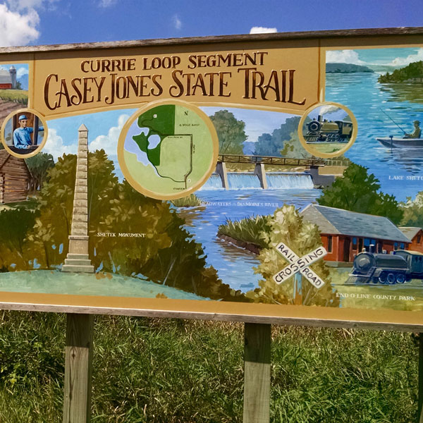 Mural painting on a trail sign for Currie Loop of Casey Jones Trail