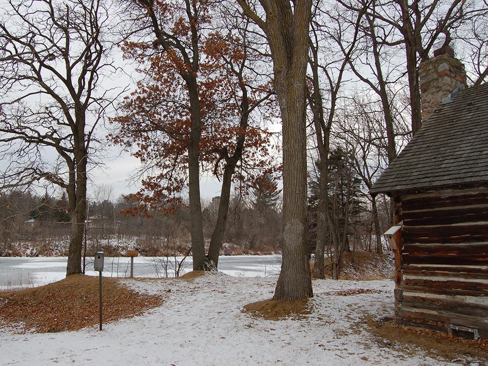 Log cabin near river edge