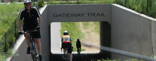 Bicyclists riding at underpass
