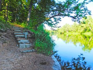 Park visitors can hike a trail along St. Croix River.