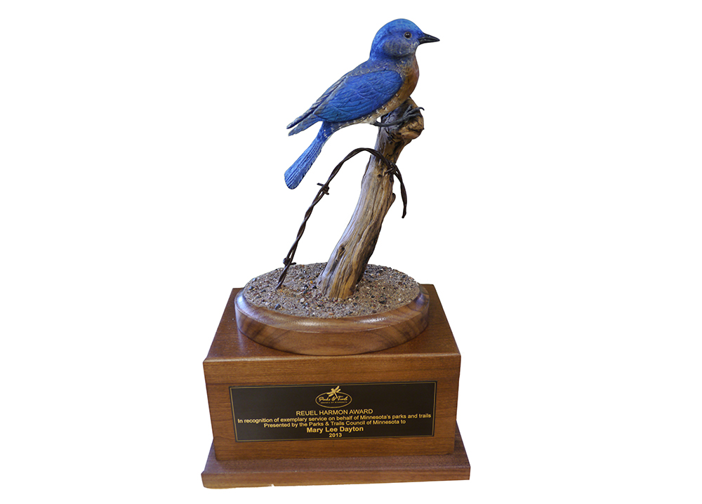 Carving of a bluejay on an award stand