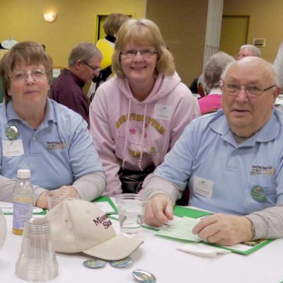 Four members of Prairie visions gathered at table