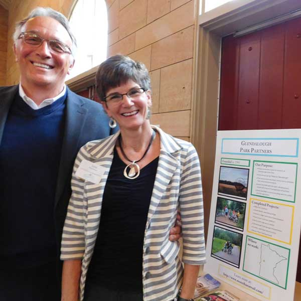 Steve Nelson and Lisa Malmstrom stand by poster for Glendalough Park Partners