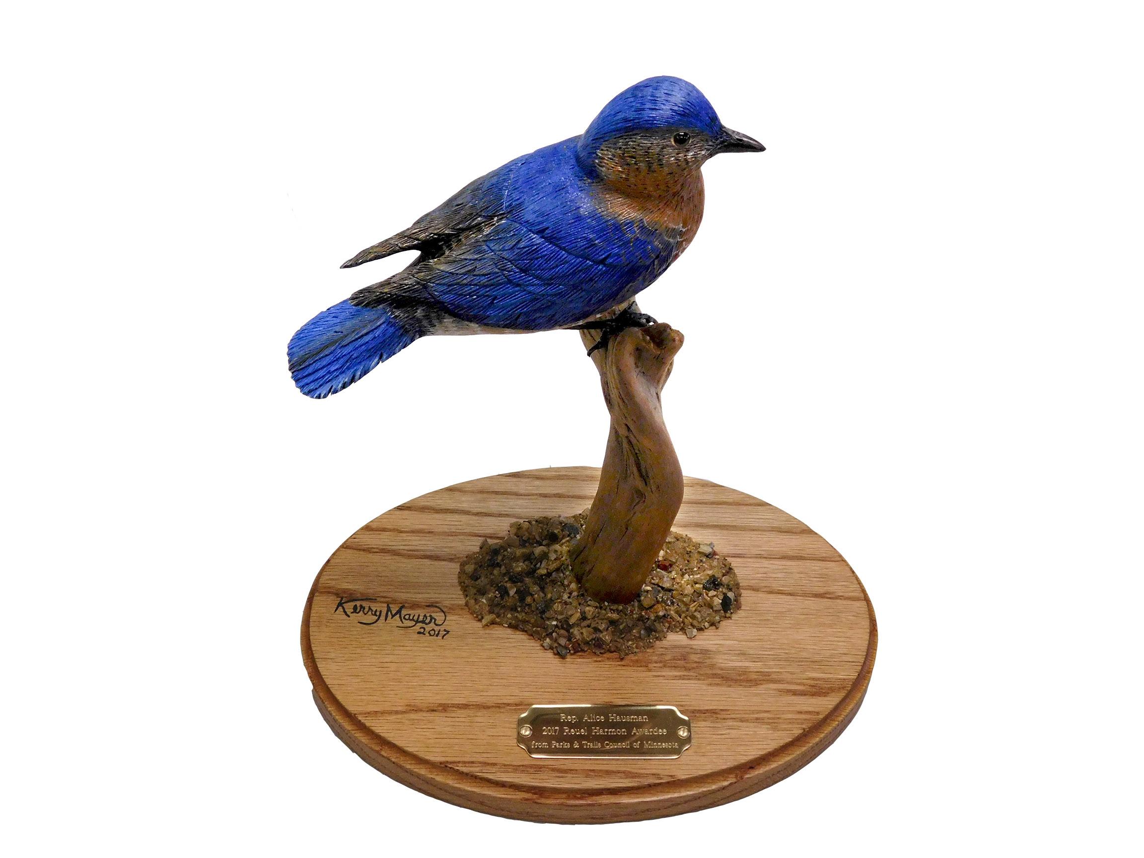 Carving of a bluebird on an award