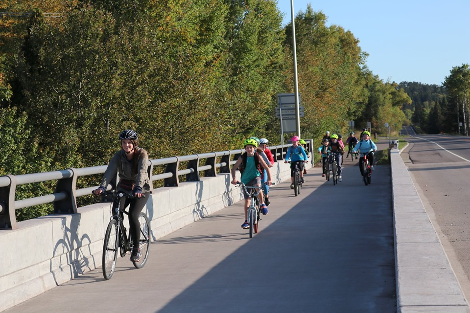 Kids bike over bridge on protected, separated bike path