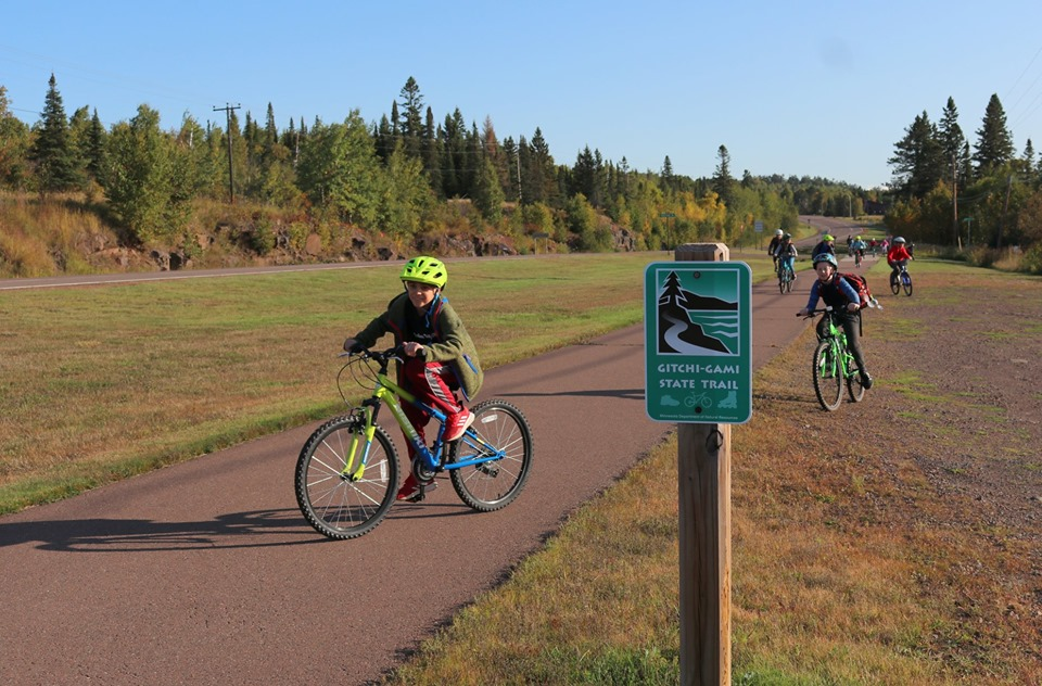 Kids biking on and off the trail