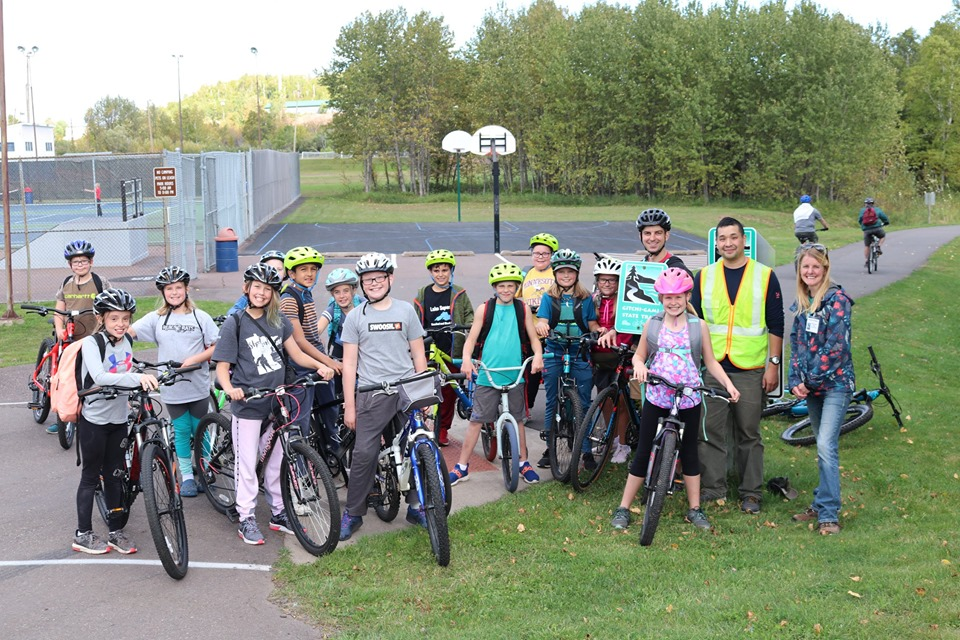 group picture on bikes back at school
