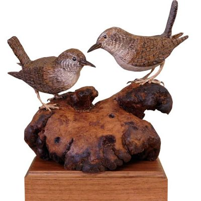 two carved wrens