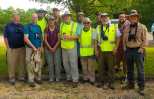 group picture with binoculars and safety vests