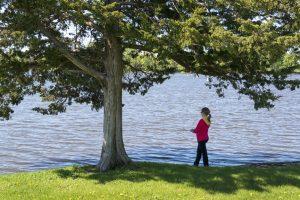 girl fishing from shore