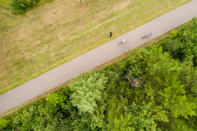 Aerial shot of bikers on trail
