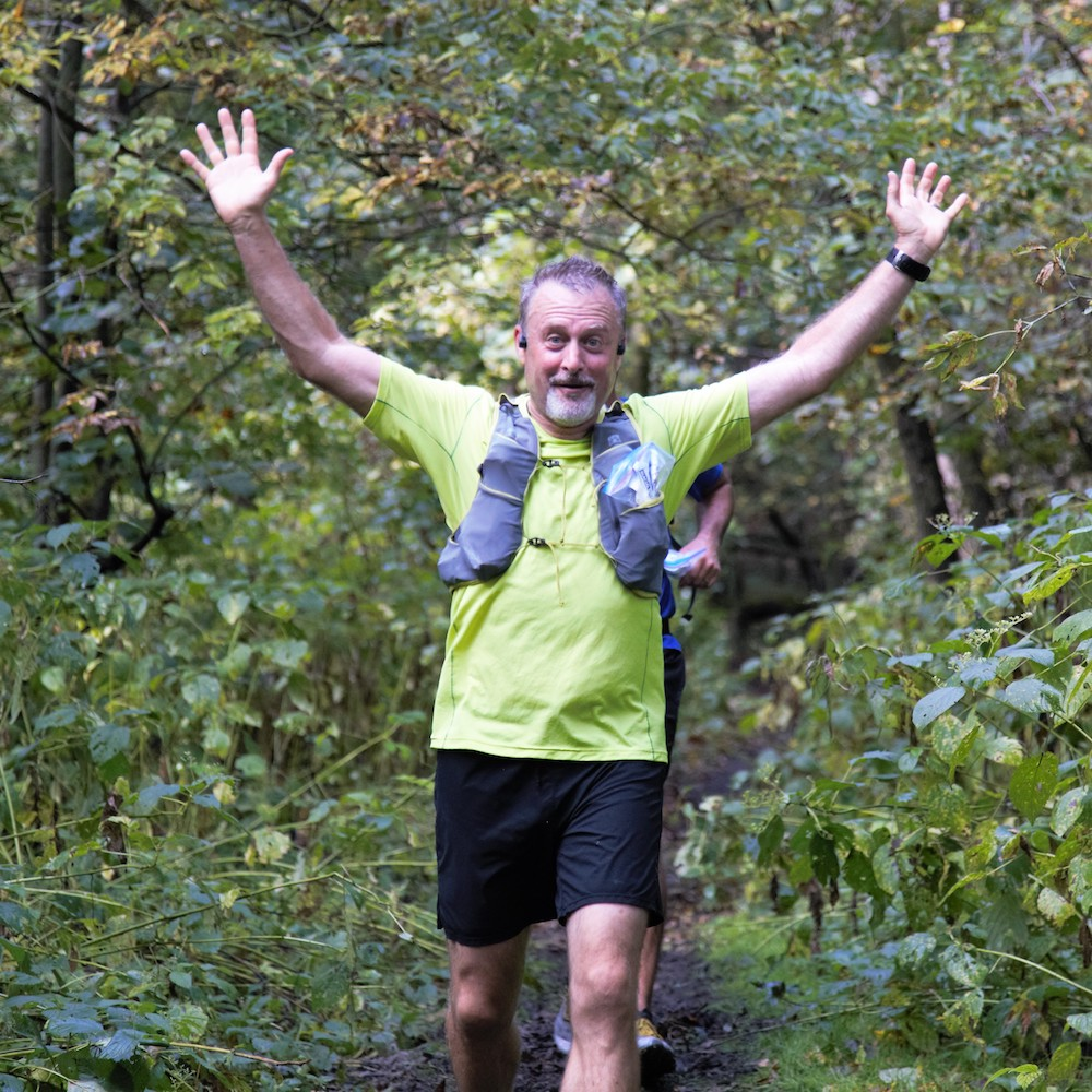 man rejoices during trail running in race