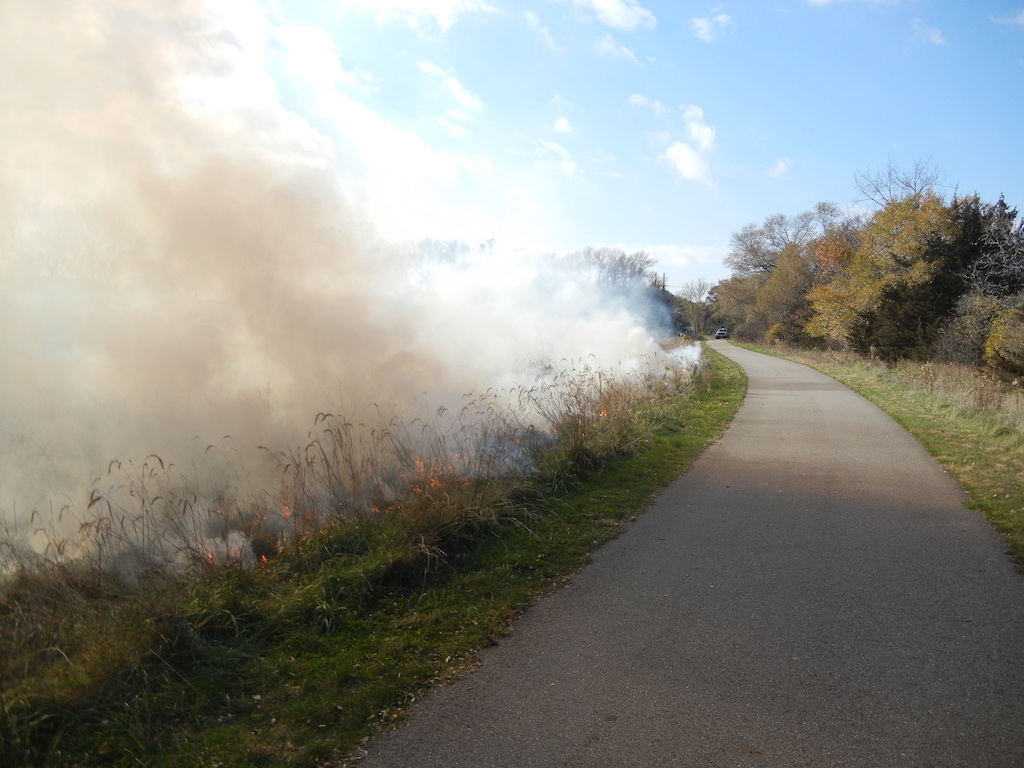 The clear bike bath is lined by smoke from a controlled burn
