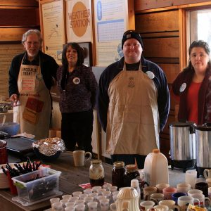 Group serving pancakes in the park visitor center