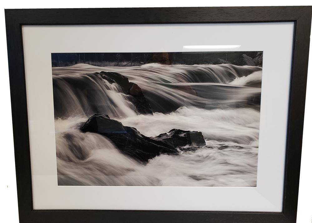 Framed black and white photo of river