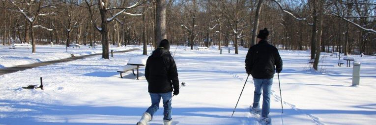 snow-shoers head out from the picnic shelter