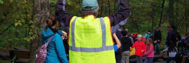volunteer in a bright yellow vest