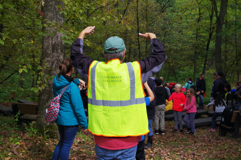 volunteer in a bright yellow vest
