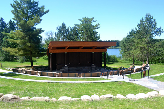 new amphitheater stage and seating with the lake in the backgroun