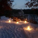 luminaries lighting the hike and snowshoe trail