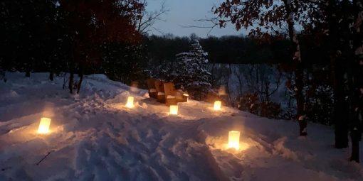 luminaries lighting the hike and snowshoe trail