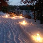 Candles along path in snow