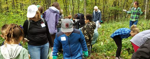 Fifth-graders explore the woods at Lake Maria