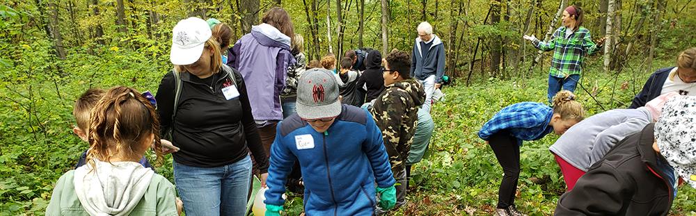 Fifth-graders explore the woods at Lake Maria