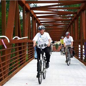 Peggy Prowe, a strong advocate for the trail riding across the bridge in Northfield named in her honor.