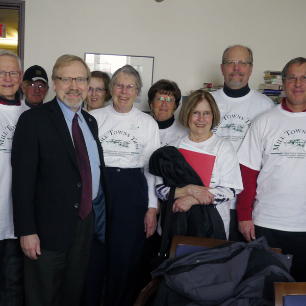 Group wearing Friends of Mill Towns shirts with Rep. Bly