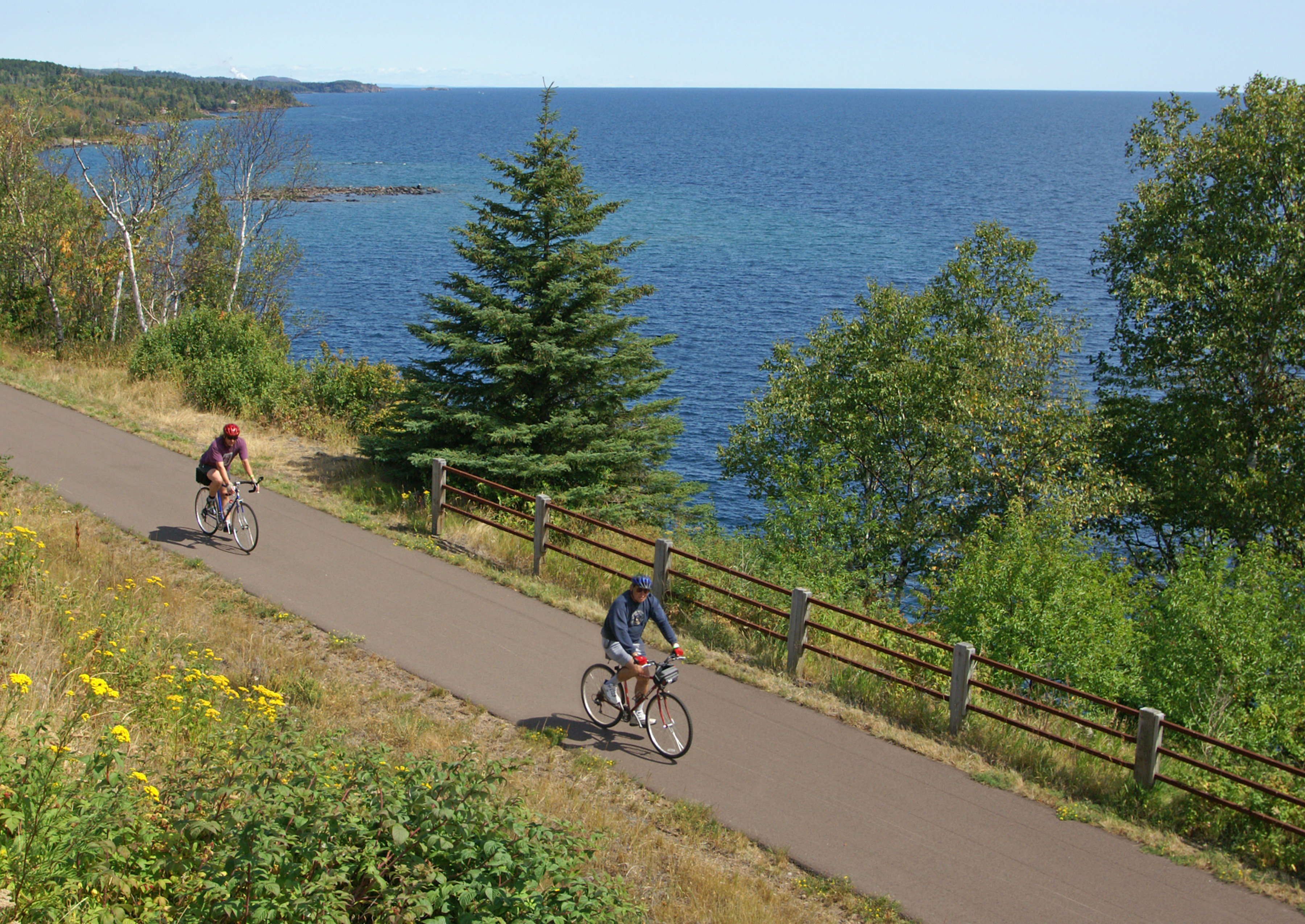 bicyclists on Gitchi Gami with Lake Superior in back
