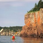 Kayakers on Lake Superior with Gold Rock Point
