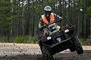 ATV rider shifting onto two wheels