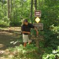 """Woman pointing to """"No ATVs Permitted"""" sign along Taconite State Trail"""