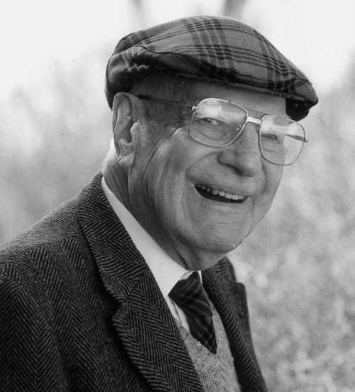 Samuel Morgan in his old age dressed in suit and tweed cap