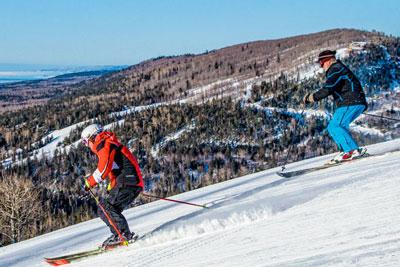 Skiers on mountain