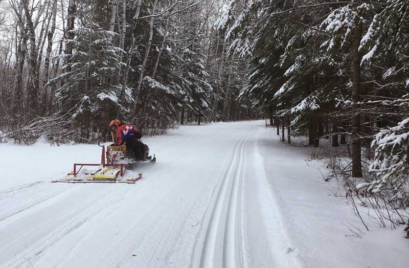 Volunteer grooming trails at Zippel Bay State Park