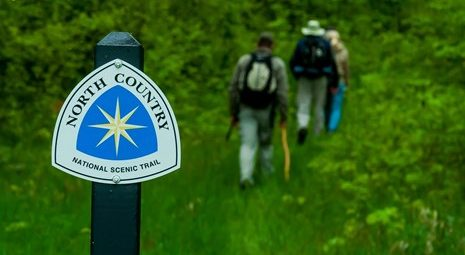 North Country Trail hikers and sign