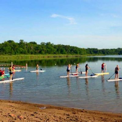 Group of people on Stand-Up Paddleboards in lake