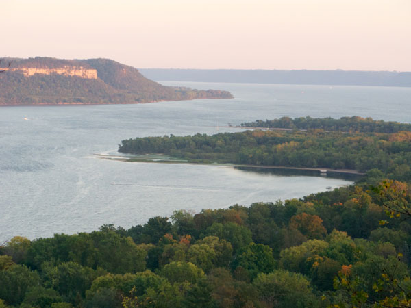 forested foreground with Lake Pepin center
