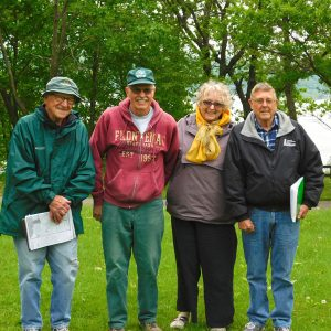 four members of the Assoc. standing in grass at Frontenac
