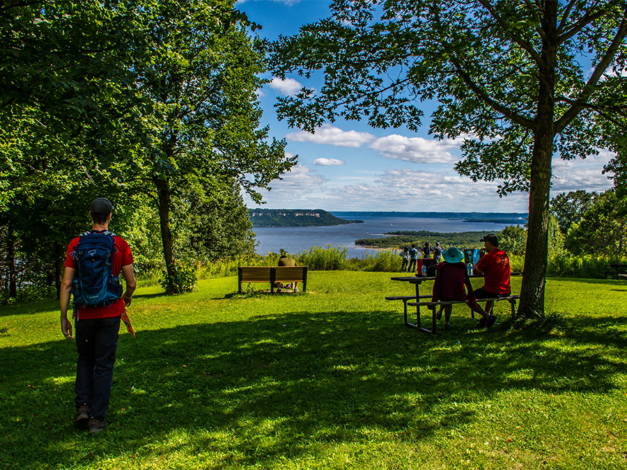 picnicker enjoying view atop bluff overlooking Lake Pepin