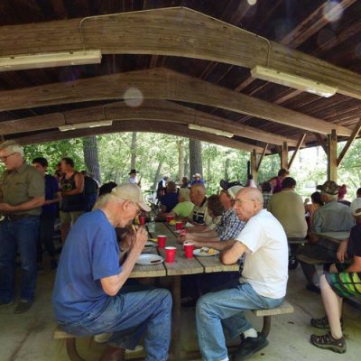 group gathered in picnic shelter