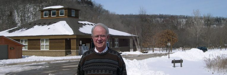 Past president Grant Merrit with bluffs saved in background