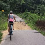 biker on Sakatah trail in need of repair
