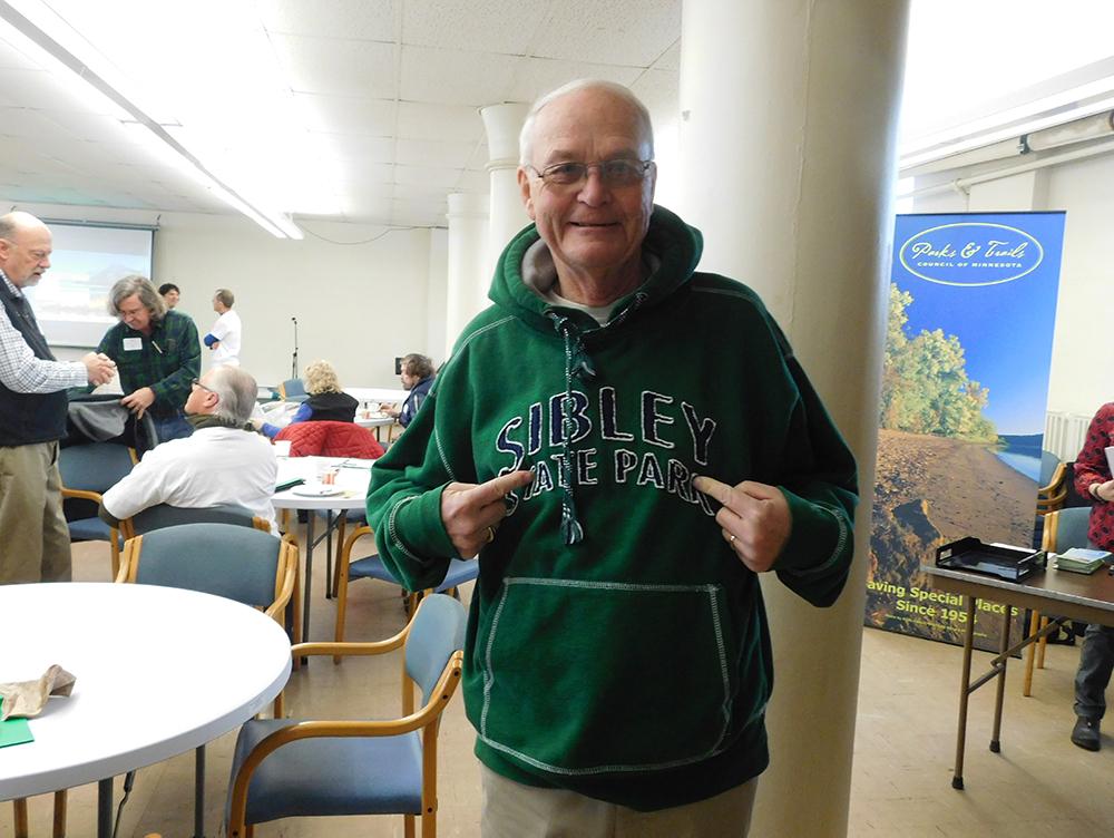 Man pointing at Sibley State Park shirt