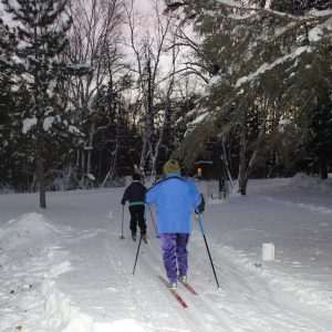 Two Friends Group members leave headquarters during a moonlight ski event.