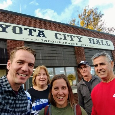 Group selfie in front of Eyota City Hall