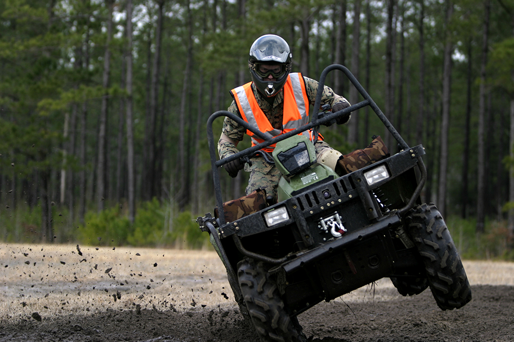 An operator taking part in the U.S. Marine Corps Forces, Special Operations Command's All-Terrain Vehicle course practices shifting his body weight